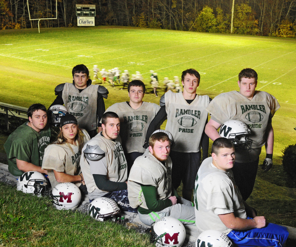 Winthrop/Monmouth offensive linemen pose for a photo on Tuesday at Maxwell Field in Winthrop. They are from left to right front row: Ryan Hafford, Jack Vickerson, Brendon Dunn, Josh Ward, Luke St. Hilaire; bottom row: Zach Wallace, Jared Gosselin, Ben Ames and Hunter Hamlin.
