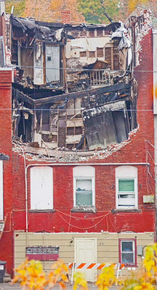 This October file photo shows the collapsed roof on 235 Water St. in Gardiner that was heavily damaged by a fire in July.