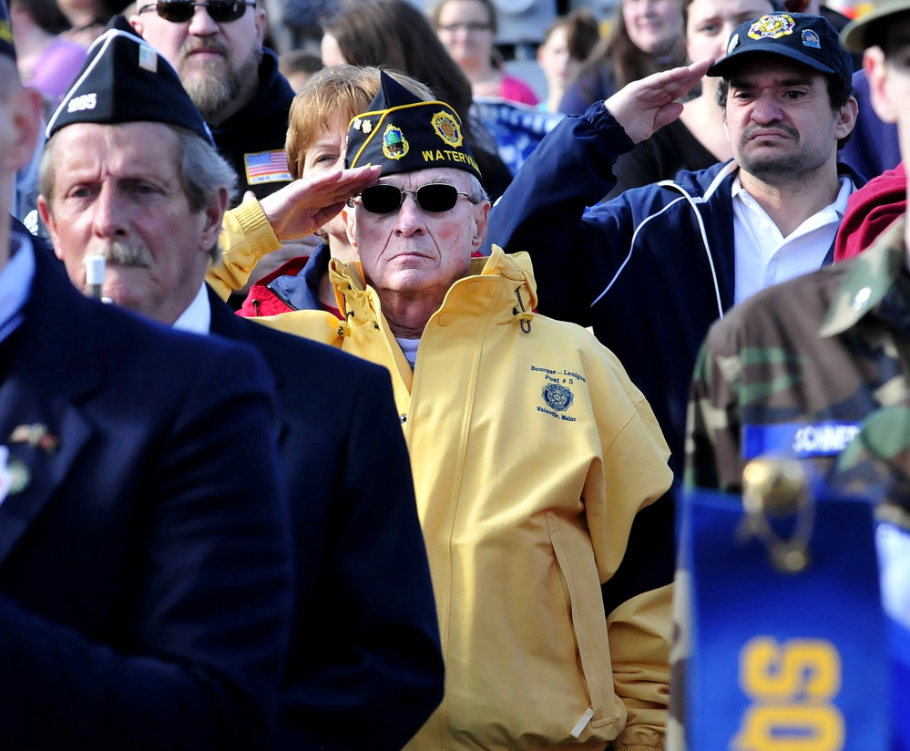 Veteran Reginald Joler salutes during a Veterans Day ceremony in Waterville on Nov. 11, 2014.
