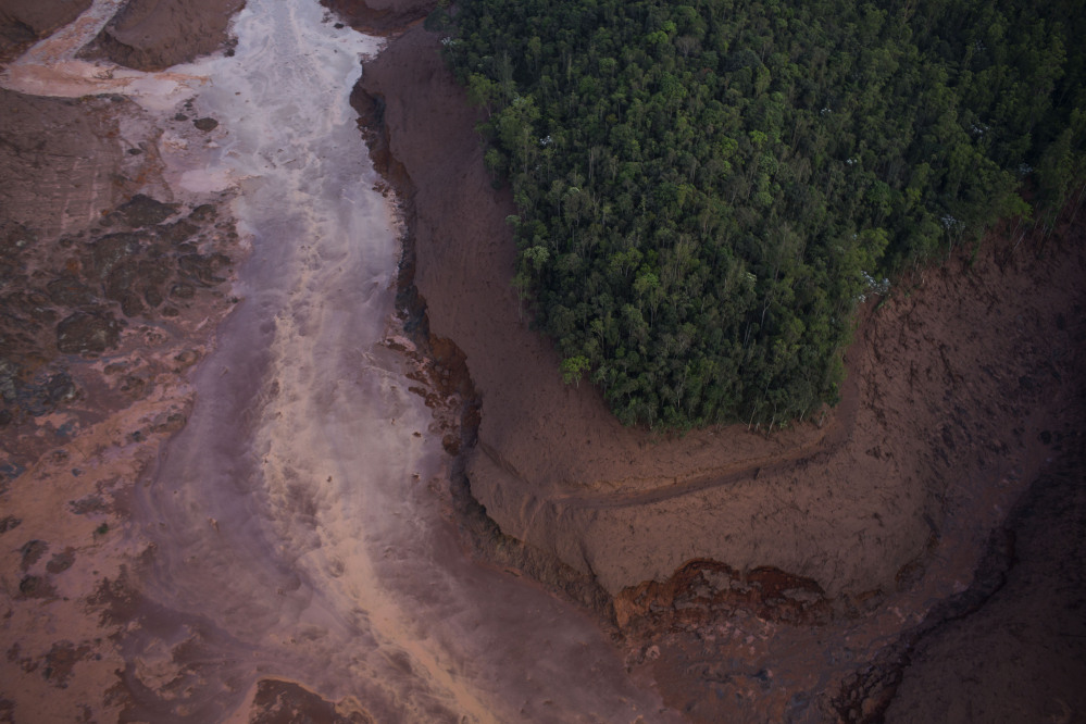 Aerial view of a mudslide after a dam burst at the small town of Bento Rodrigues in Minas Gerais state, Brazil, on Friday.
