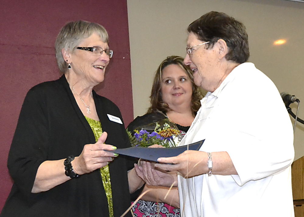 Mary O'Donal, right, receives special recognition from the Franklin County Chamber of Commerce for 55 years of service at Franklin Memorial Hospital. From left are Franklin County Chamber board members Shannon Smith and Jodi Cordes.