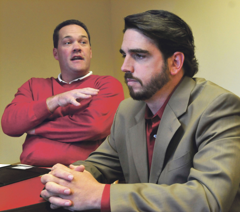 Attorney Gregg Frame, left, and his client, Waterville Senior High School Principal Don Reiter, speak with the Morning Sentinel about Reiter's upcoming public hearing with the Board of Education over whether he should be dismissed from his job.