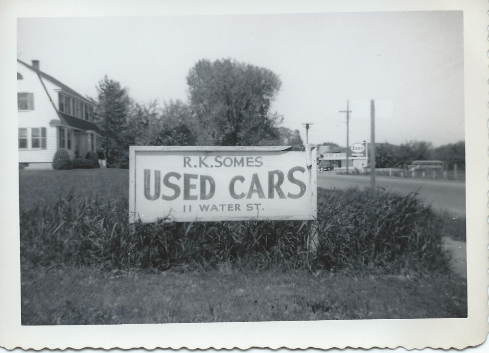 The business sign advertising cars for sale at Somes Used Cars on Water Street on the Hallowell-Augusta line.