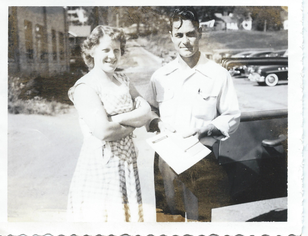 Elizabeth Somes and Robert K. Somes Sr. in front of their Water Street business on the Hallowell-Augusta line.