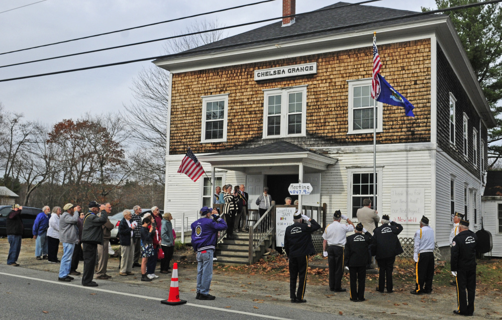 Attendees salute on Saturday during the dedication of a new flagpole at the Chelsea Grange hall.