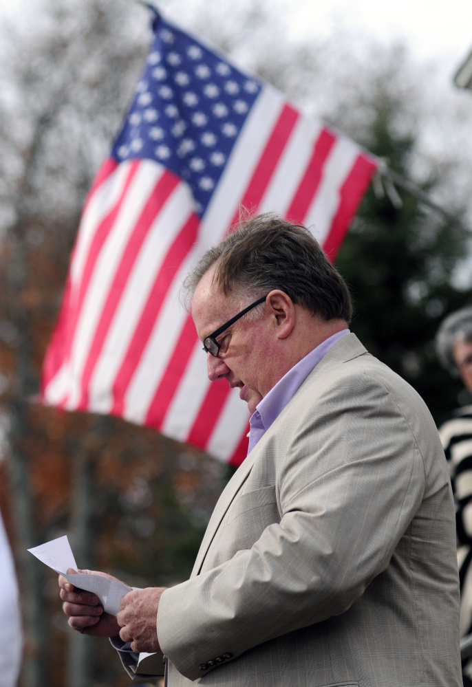 Tim Morgan reads a poem by Civil War soldier Charles Searles during the dedication of a new flagpole in Searles' honor Saturday at the Chelsea Grange hall.