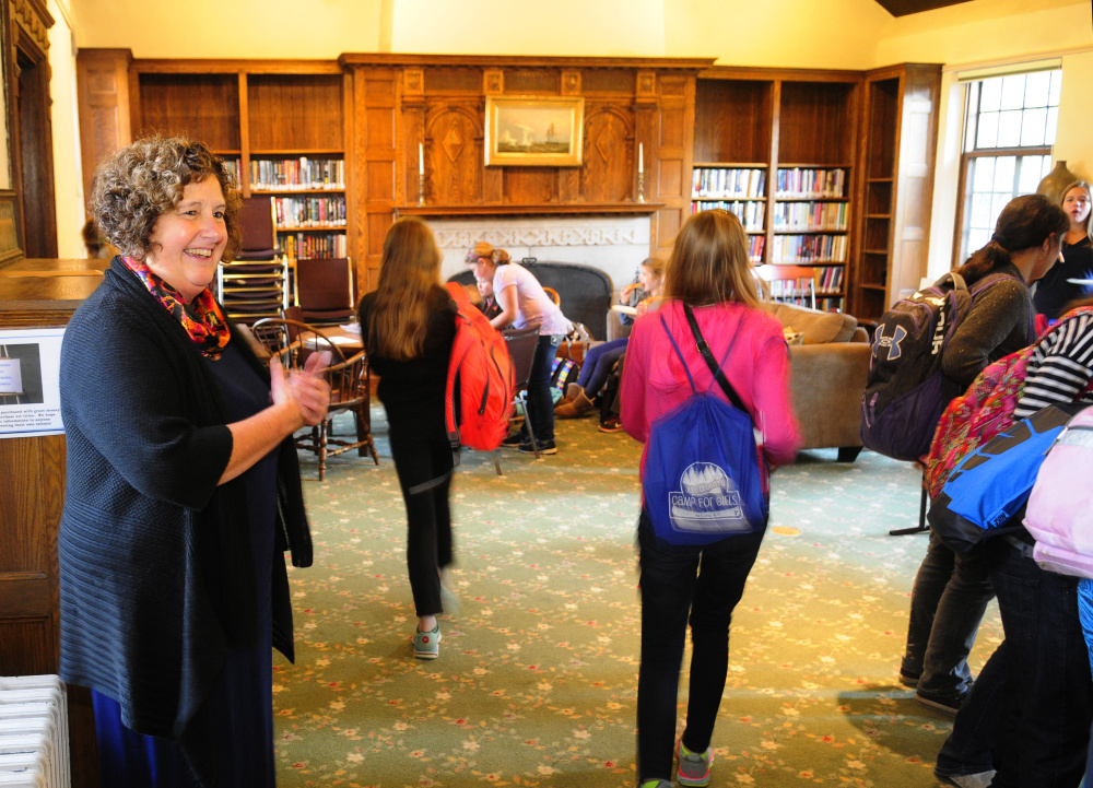 Library Director Anne Davis greets a group of middle school students as they walk into Hazzard Reading Room for a weekly after-school program on Thursday at Gardiner Public Library.