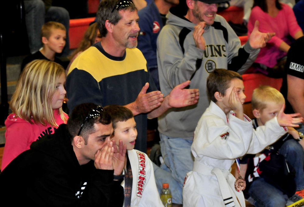 Fans cheer on team members during Maine Skirmish event Sunday in Winslow.