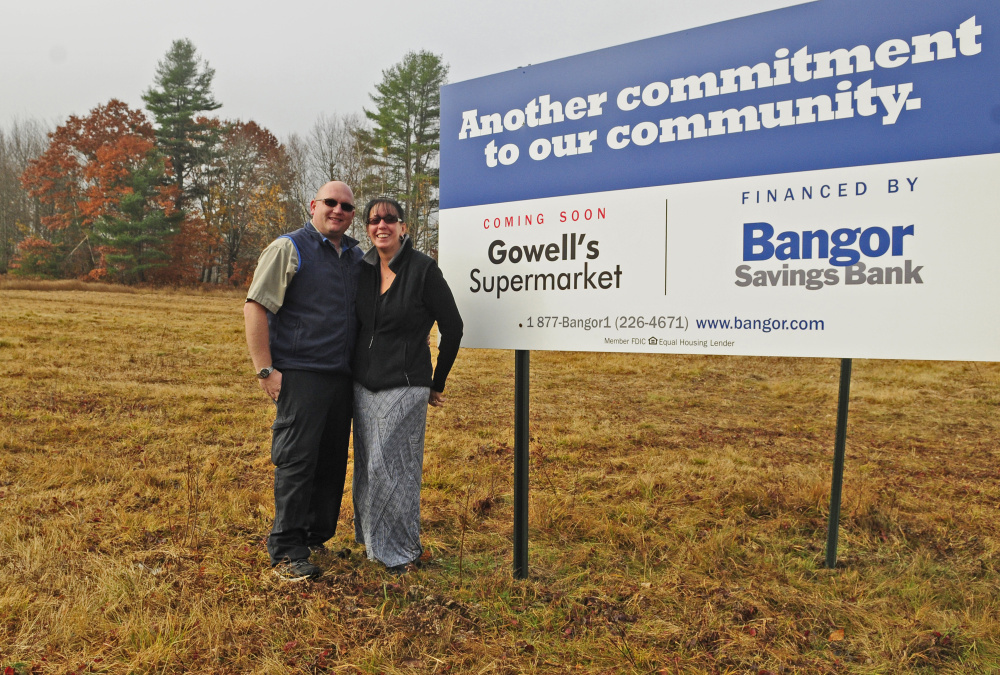 Rick and Bobbi Gowell on Thursday stand in a field where the new Gowell's Supermarket will open next year in Litchfield.