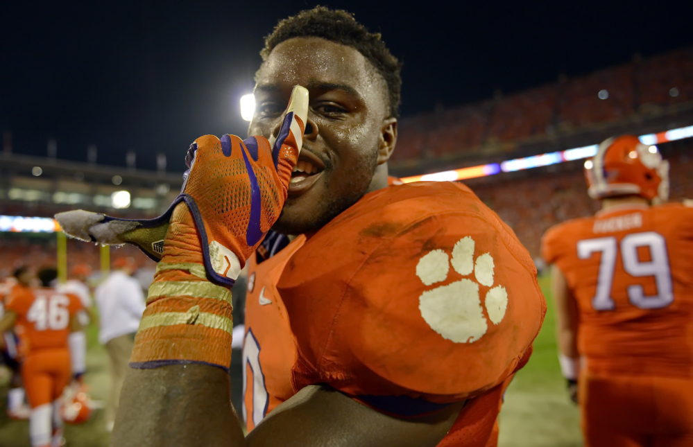 Clemson's Shaq Lawson celebrates in the closing minutes after their 23-17 win over Florida State on Saturday in Clemson,  S.C.
