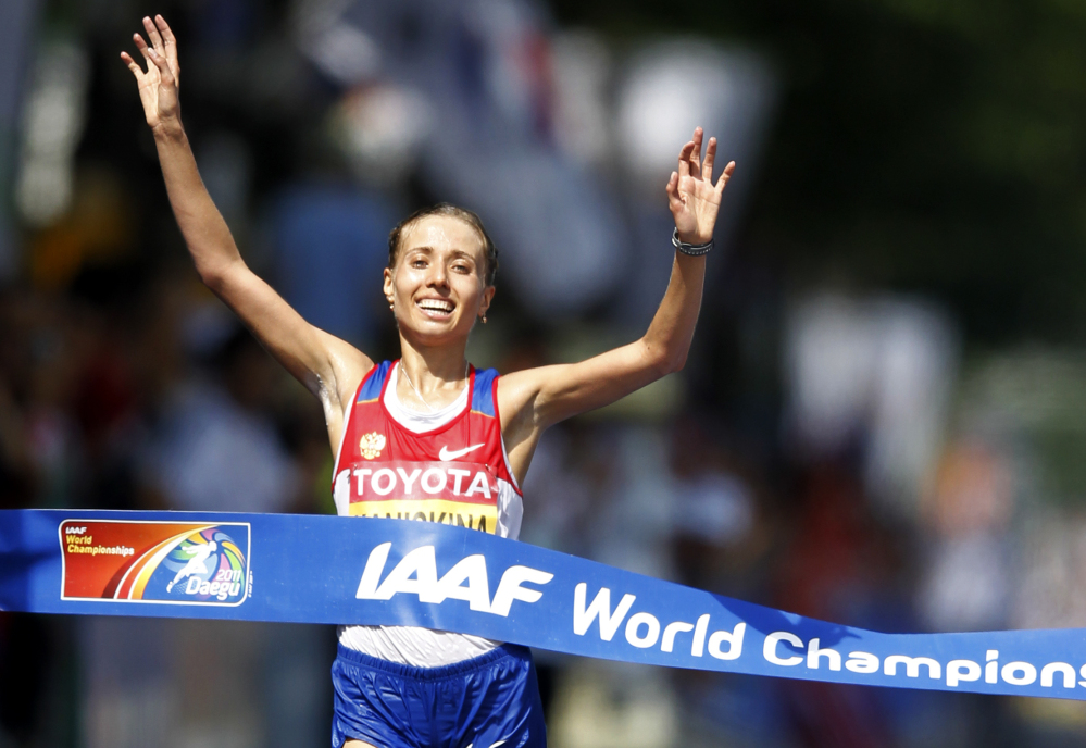 In this Aug. 31, 2011 file photo Russia's Olga Kaniskina reacts as she crosses the finish line to win the Women's 20km Race Walk at the World Athletics Championships in Daegu, South Korea.