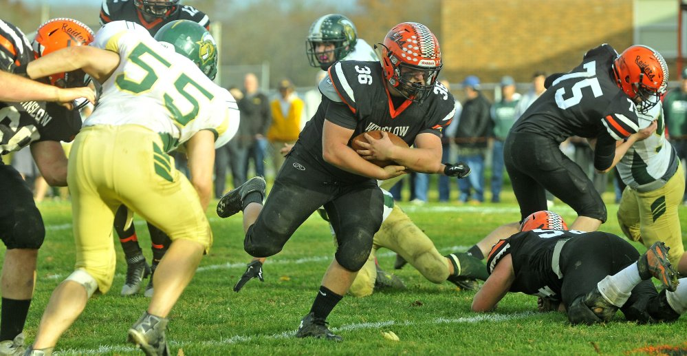 Winslow running back Kenny Rickard (36) runs the ball in for a touchdown during a Big Ten Conference semifinal Saturday against Mt. Desert Island at Poulin Field in Winslow. The Raiders rolled to a 21-0 victory and will travel to Old Town on Friday for the BTC championship game.