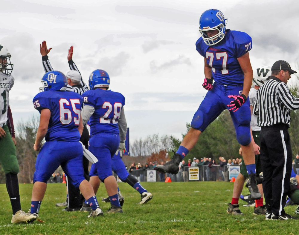 Oak Hill offensive lineman Austin Gaucher leaps for joy after Dalton Therrien scored the Raiders' first touchdown during a Campbell Conference Class D semifinal game Saturday in Wales.