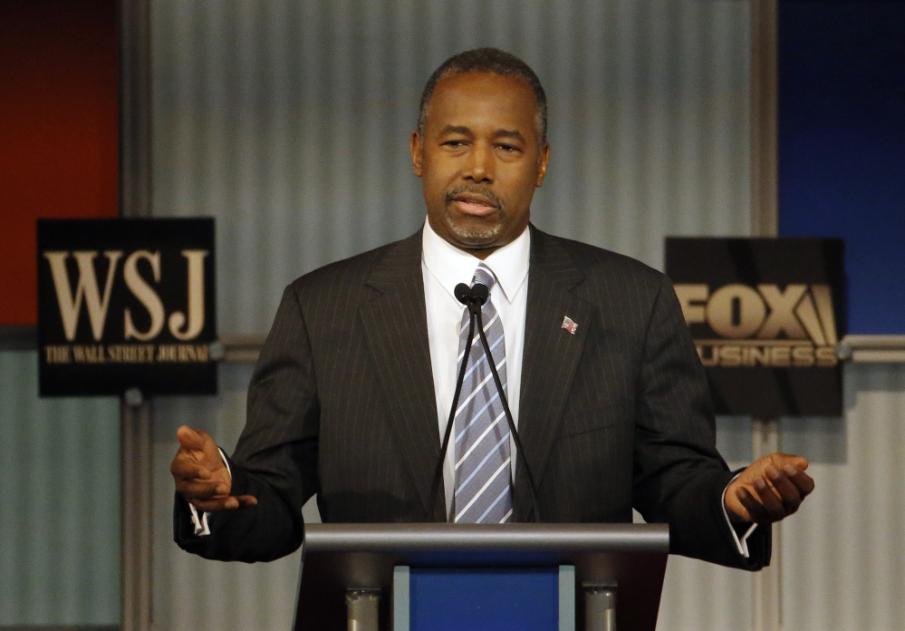 "Ben Carson speaks during Republican presidential debate Tuesday night. Carson, who has been questioned about the truth of his biography, said, ""I have no problem with being vetted. What I do have a problem with is being lied about."""