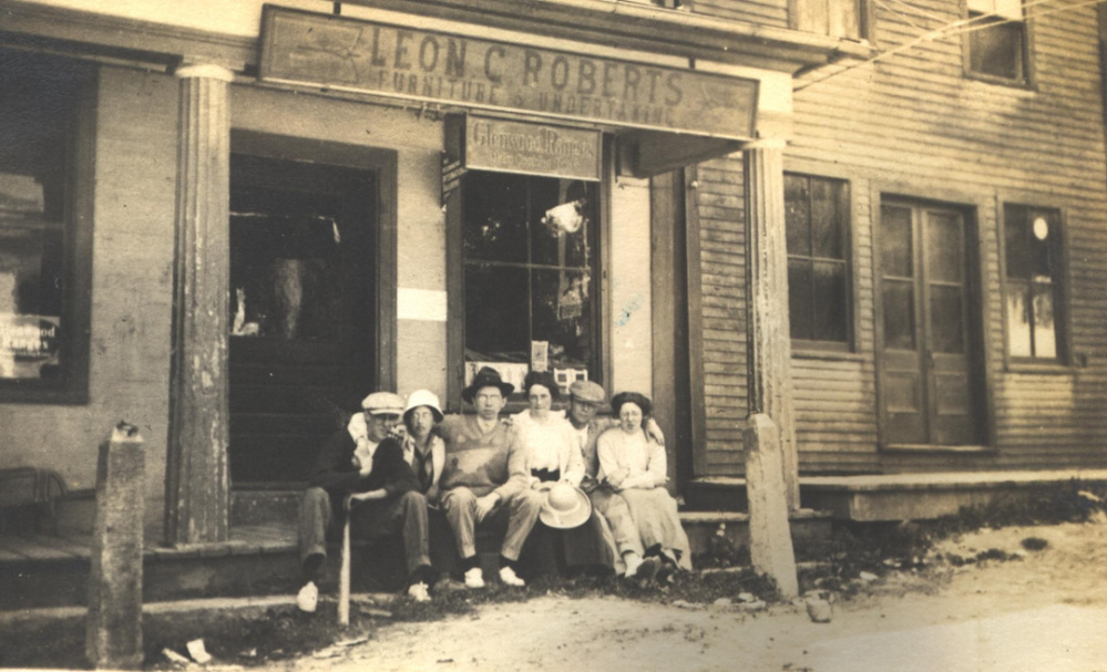 In this newly discovered circa 1920 photo are several Readfield residents sitting in front of Leon Roberts Furniture and Undertaker Store at Readfield Corner. Roberts' store was located on the first floor of the original Masonic Block and was one of businesses destroyed in the fire of 1921. After the fire Roberts moved his store and funeral home business to Winthrop.