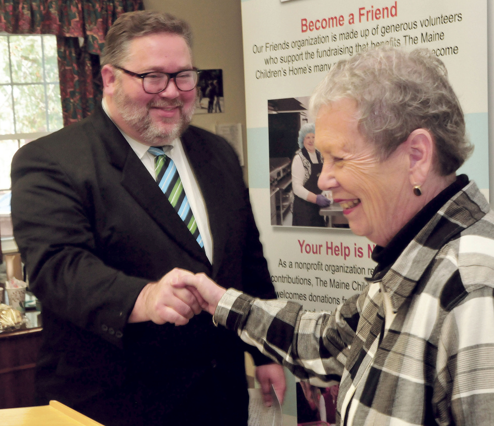 Maine Children's Home for Little Wanderers Executive Director Sharon Abrams congratulates Richard Dorian after the announcement that he will become the new director at the Waterville nonprofit organization on Tuesday. Abrams will retire at the end of the year.