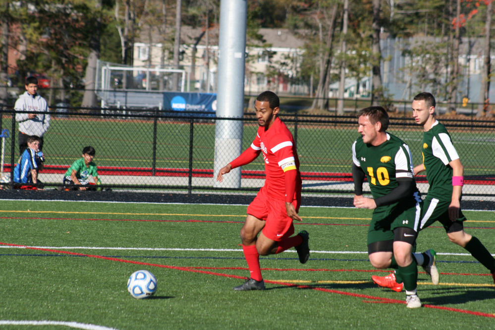 Thomas College's Tre Ming (center) dribbles the ball up the field in a game played earlier this season in Waterville. Ming, the North Atlantic Conference men's soccer Player of the Year, and the Terriers take on Brandeis in the opening round of the NCAA Division III tournament Saturday in Waltham, Massachusetts.