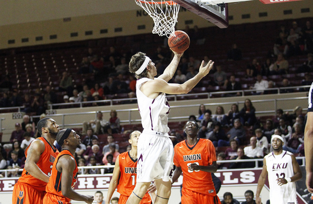 Eastern Kentucky freshman Nick Mayo goes up for a layup during an exhibition game against Union College  (Kentucky) on Sunday. Mayo, a former Messalonskee standout, scored 17 points in the victory.