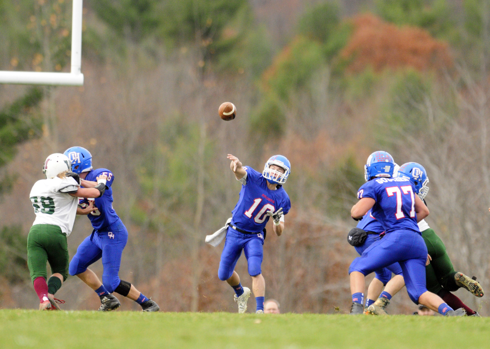 Oak Hill quarterback Dalton Therrien throws a pass against Winthrop/Monmouth during a Campbell Conference Class D semifinal game Saturday in Wales.