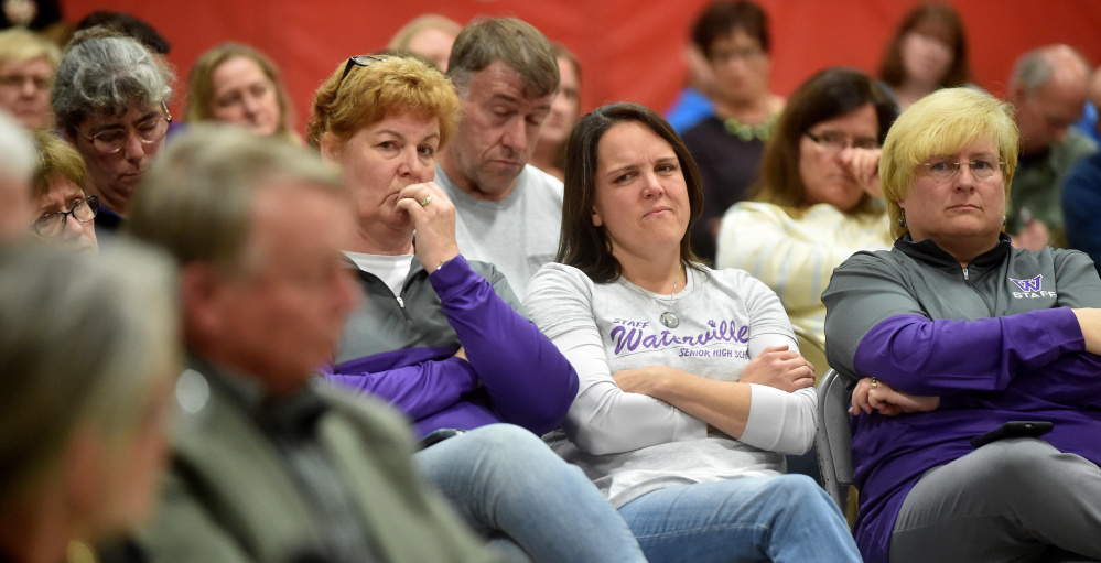 Audience members listen to some of the public testimony Wednesday night at the Board of Education hearing on Waterville Senior High School Principal Don Reiter's dismissal recommendation. Much of the seven-hour hearing was being closed doors, angering many who attended.