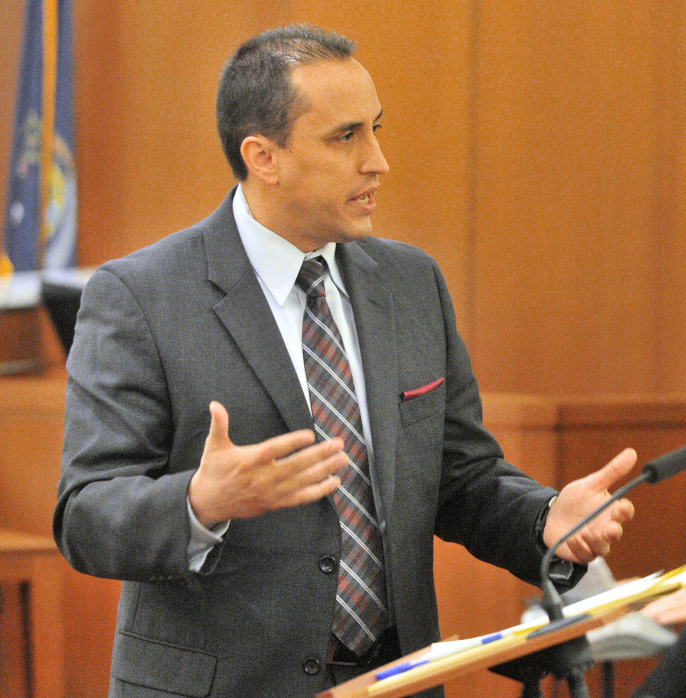Defense attorney Darrick Banda speaks to the jury during opening statements in the Capital Judicial Center on Thursday in the trial jury trial of Roland L. Cummings, accused of murdering 92-year-old Aurele Fecteau in May 2014 in Fecteau's Waterville home.