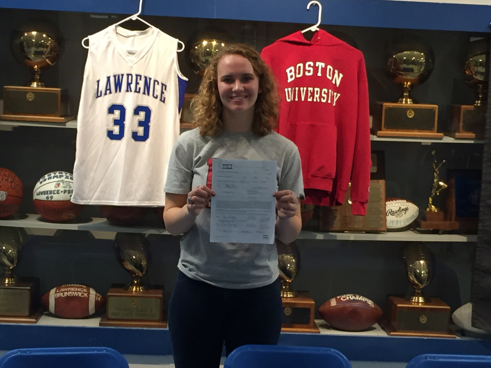 Lawrence senior Nia Irving holds her National Letter of Intent she signed to attend Boston University on Friday night in Fairfield.
