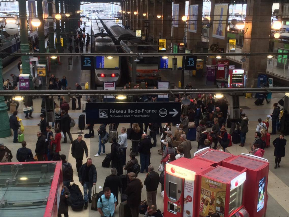 The Gare du Nord station is crowded Saturday as people attempt to board their trains out of Paris.