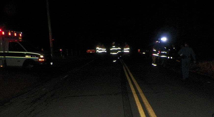 Emergency responders converge on the scene on Ferry Street in Solon Friday night, where Joshua Sincyr of Norridgewock was killed when he was hit by a pickup truck driven by Seth Burns of Embden.
