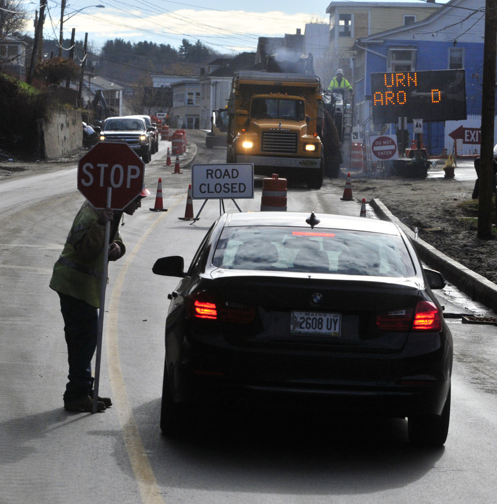 Flagger Devin Pooler explains to a southbound driver on Mount Vernon Avenue in Augusta on Friday that one-way traffic is up ahead and so they must turn around. The road is expected to open to two-way traffic on Friday.