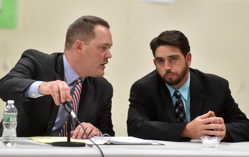 Gregg Frame, left, confers with his client, Waterville Senior High School Principal Don Reiter, on Wednesday night at Reiter's dismissal hearing. Waterville police said Sunday they have received communications from former students of Reiters in New Hampshire alleging the same type of behavior — propositioning a student — that he is accused of in Waterville.