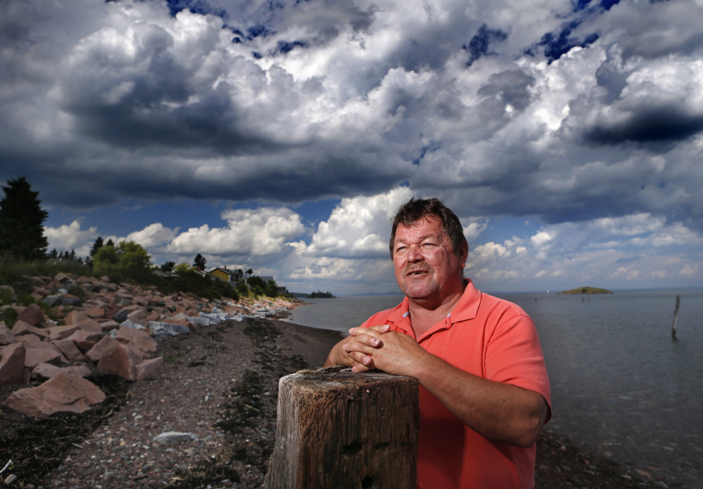 In this July 31 photo, Passamaquoddy tribal Chief Frederick J. Moore poses on the waterfront at Pleasant Point. A century after the state outlawed the salmon spear fishing that fed their ancestors, Native American tribes who trace their history back millennia say their trust in the government of Maine is at an all-time low.