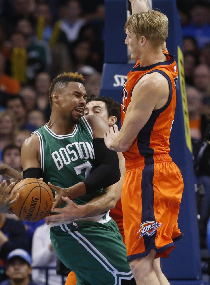 Boston Celtics center Jared Sullinger (7) is fouled by Oklahoma City Thunder forward Nick Collison, center, as Thunder forward Kyle Singler, right, also defends in the second quarter Sunday in Oklahoma City.