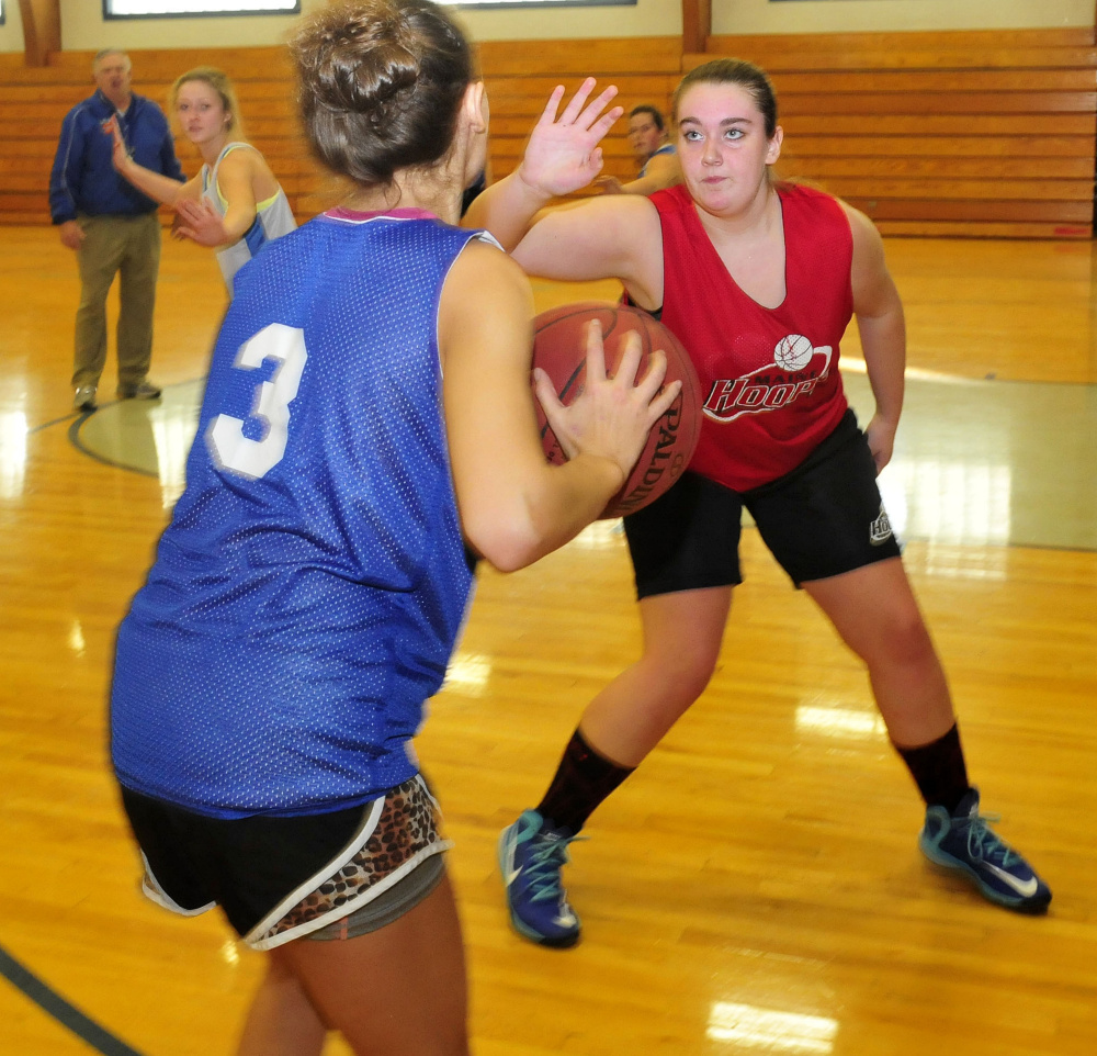 Staff photo by David Leaming Lawrence players Elise Guimond, left, and Olivia Gray go through drills during practice Monday.