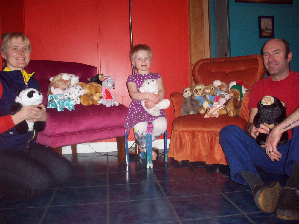 The Ziemer family, from left, Ariel, Gudran and Morgan, with stuffed animals that were donated the first two days of the campaign.
