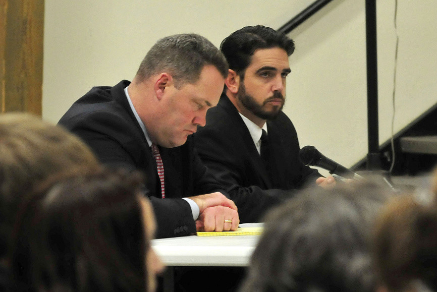 Attorney Gregg Frame, left, and former Waterville Senior High School Principal Don Reiter listen to the proceedings at Monday night's dismissal hearing.