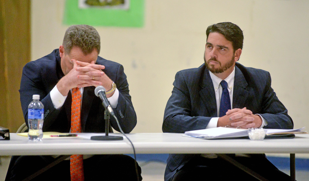 Don Reiter, right, former Waterville Senior High School principal, listens during a public hearing at the George J. Mitchell School in Waterville on Nov. 10. The Waterville Board of Education on Monday voted to dismiss Reiter as principal and the Kennebec County District Attorney's Office plans to announce Thursday whether criminal charges will be brought against him.