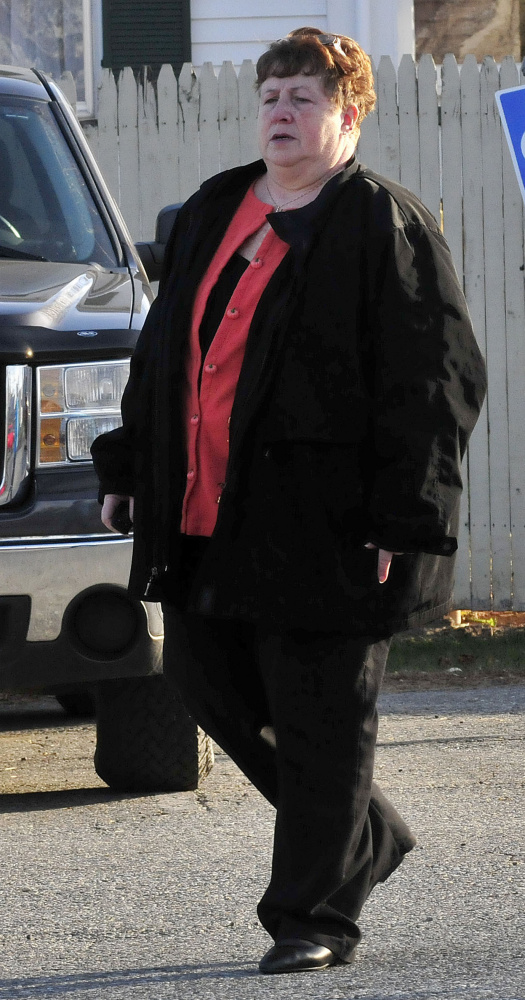 Former district attorney office secretary Julie Smith leaves Somerset Superior Court in Skowhegan Wedmesday following a hearing on charges of embezzling funds and tampering with public records.