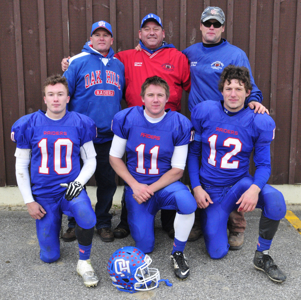 Members of the Oak Hill 1982 Class D state championship team — Don Therrien, Billy Martin and Gordon Strout — pose with their sons, Dalton Therrien, left, Jonah Martin and Matthew Strout last Saturday in Wales.