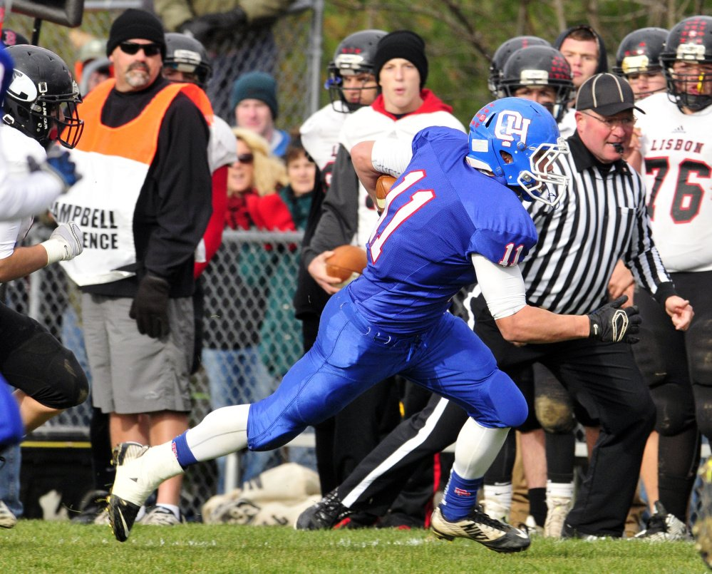 Oak Hill's Jonah Martin runs the ball during the Class D South title game against Lisbon on Saturday in Wales.