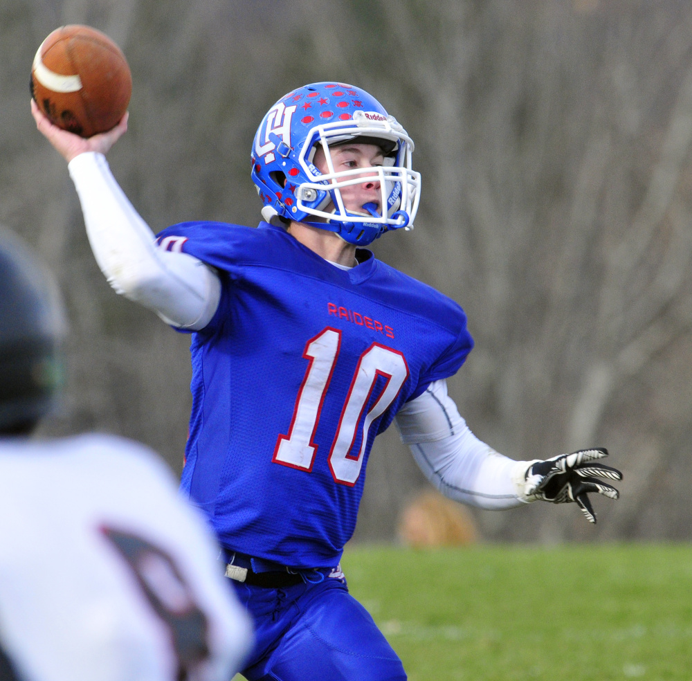 Oak Hill quarterback Dalton Therrien throws a pass during the Class D South title game against Lisbon on Saturday in Wales.