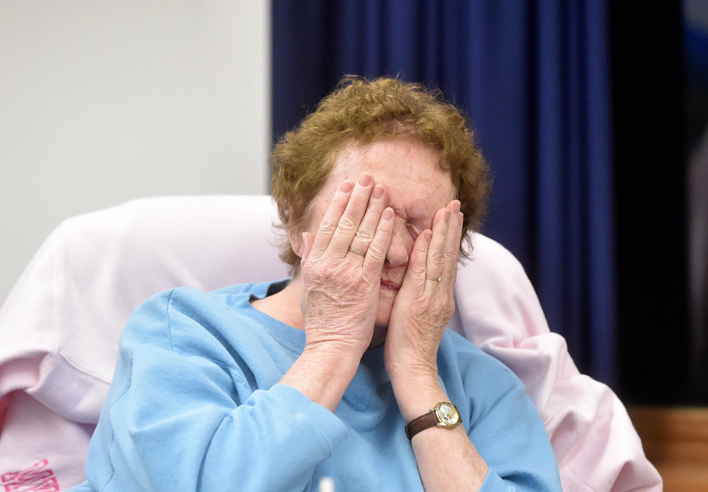 Charlotte Curtis, selectman, wipes her eyes as the open session meeting carries on at the town office in Norridgewock on Wednesday