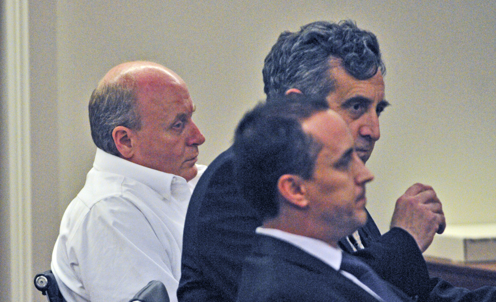 Staff photo by Joe Phelan Roland L. Cummings, left, sits beside his defense attorneys Ronald Bourget, top, and Darrick Banda while the jury delivers the guilty verdict on Thursday in Capital Judicial Center in Augusta.