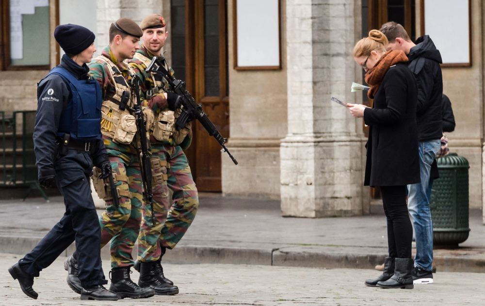 Belgian Army soldiers and a police officer patrol in the Grand Place in the center of Brussels on Friday.