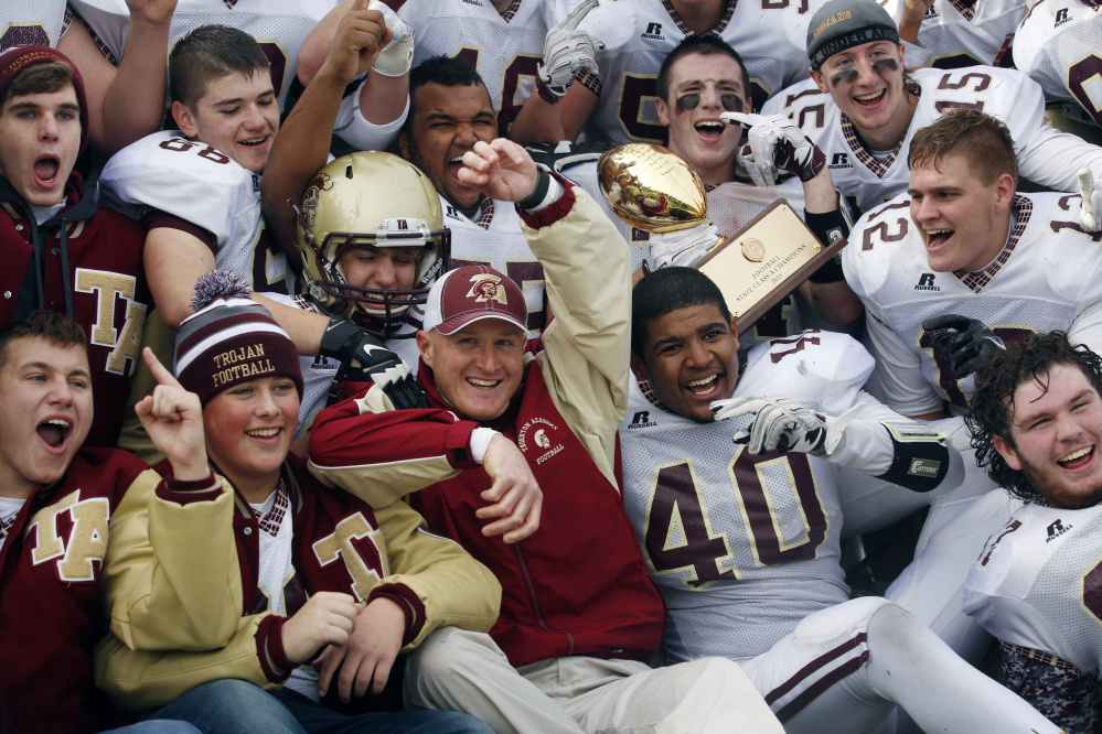 Coack Kevin Kezal and the Thornton Academy football players have that golden glow Saturday after winning the Class A championship for the third time in four seasons with a 24-14 victory against Portland at Fitzpatrick Stadium.