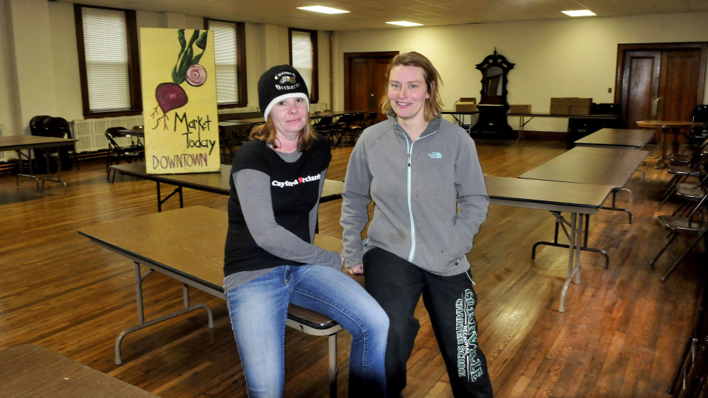 Farmers Heather Davis, left, of Cayford Orchards and Sarah Smith of Grassland farm will be among area farmers participating in selling products at the farmers market now inside the Skowhegan Masonic Hall.