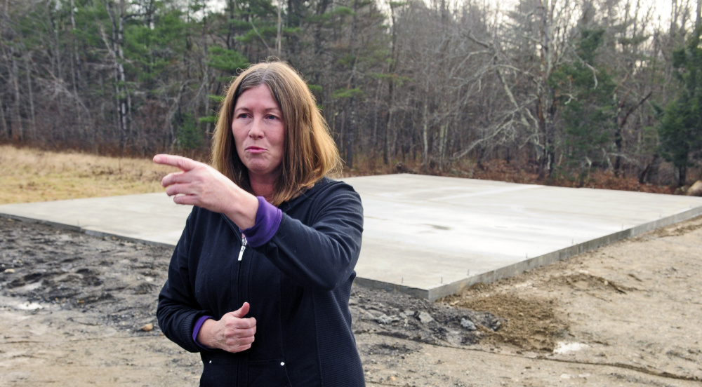 Standing in front of foundation that was recently poured to build a new barn for her cows at her Richmond home, Daria Goggins talks to reporters on Saturday about finding her pair of Herefords shot on Friday afternoon.