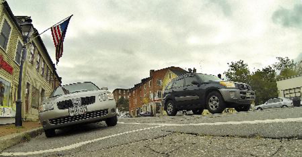 The slope of Water Street in Hallowell, caused by a raised crown in the middle of the road, makes it difficult for customers who park on the east side of the street.