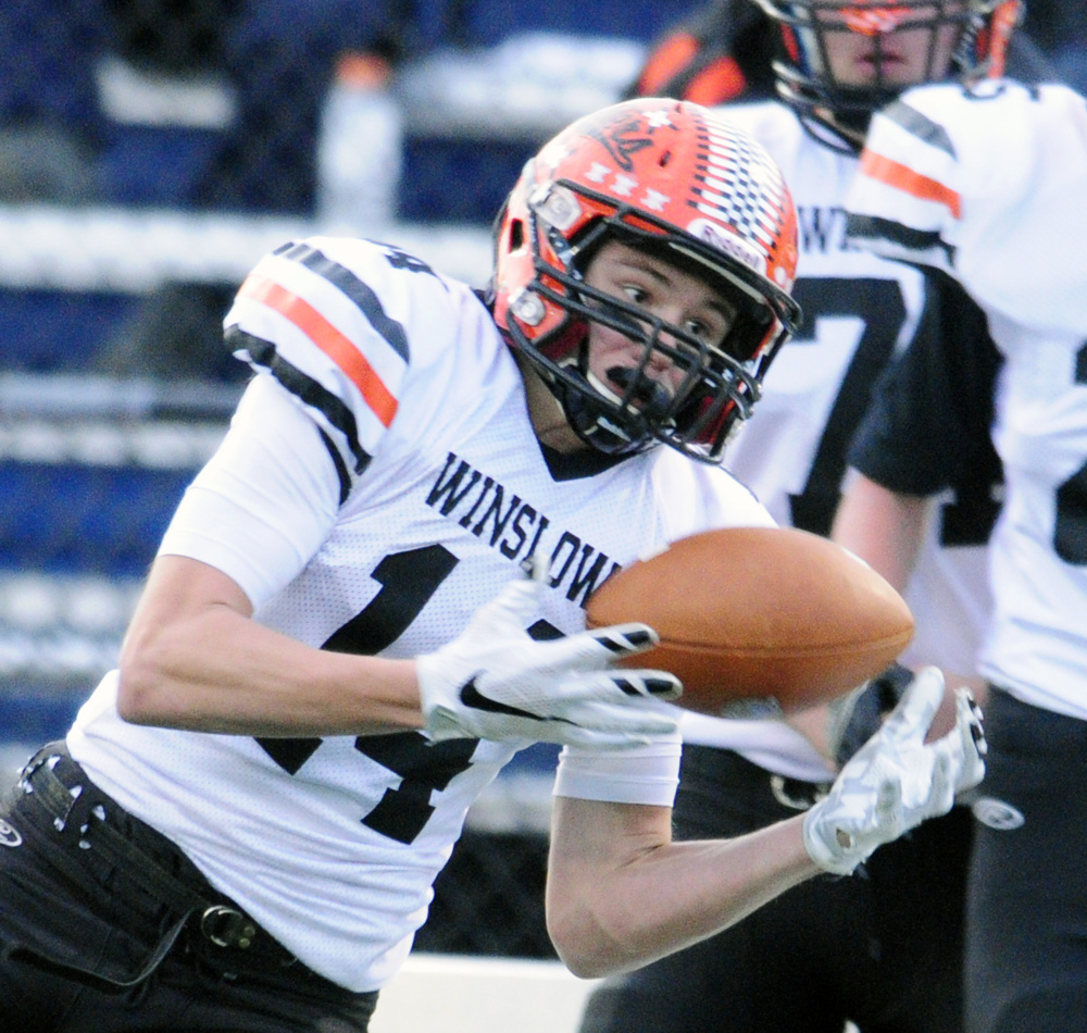 Winslow wide receiver Dylan Hutchinson hauls in a pass during the Class C state championship game against Yarmouth on Saturday at Fitzpatrick Stadium in Portland.