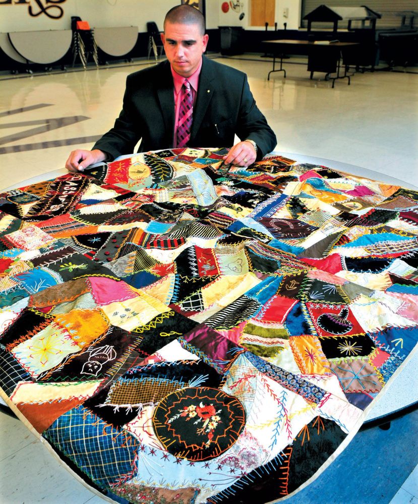 Staff file photo Waterville Senior High School principal Don Reiter in 2010 displays a quilt that had been made for the Class of 1886. Reiter was considered a charismatic and engaged leader of the school, where he'd been principal since 2007.