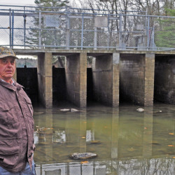 Tacoma Lakes Association President Bruce Doyle talks Friday about recent repairs to the Upper Purgatory Dam in Litchfield.